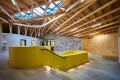 Bayreuth Youth Hostel: The timber support frame of the roof becomes a design element inside the building.