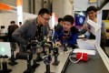 LASER World of PHOTONICS CHINA: Exhibitors and visitor communicate